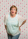 Startled pregnant woman on polka dot background Stock Images