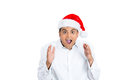 Startled surprised man in santa hat closeup portrait of shocked and handsome young wearing red claus hands air mouth eyes wide Stock Photography