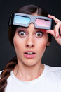 Startled woman in 3d glasses Stock Photography