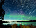 Startrails northern lights display lake laberge astrophotography star trails on midsummer night sky with aurora borealis or over Royalty Free Stock Photos