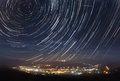 Startrails over the town Royalty Free Stock Photo