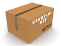 Startup kit box in cardboard taped on top end on white background concept of help with starting any project business and build Royalty Free Stock Images