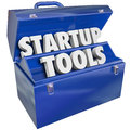 Startup tools toolbox tips advice information words in a blue metal to illusrate new business or company launch Stock Image