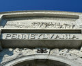 State of pennsylvania inscribed in a monument with a skyline background Stock Photography