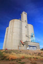 Stately grain elevator a large busy to collect and ship wheat in grass valley in eastern oregon under clear blue skies Stock Photo