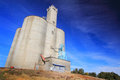 A stately grain elevator large busy to collect and ship wheat in grass valley in eastern oregon under clear blue skies Royalty Free Stock Image