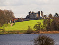 A stately home across a lake view of an english from Royalty Free Stock Photography