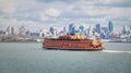 Staten Island Ferry and Lower Manhattan Skyline - New York, USA Royalty Free Stock Photo