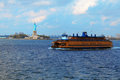 Staten island ferry and statue of liberty new york harbor new york city usa Stock Photos