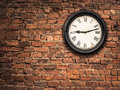 Station Clock On A Red Brick Wall Royalty Free Stock Photo