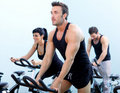 Stationary spinning bicycles fitness group Stock Image