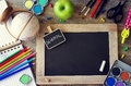 Stationery with chalk board and terrestrial globe back to schoo pencils paints school learning concept copy space background Royalty Free Stock Images
