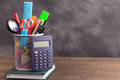Stationery items with calculator at left side on wooden table Royalty Free Stock Photo