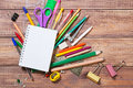 Stationery objects on wooden background Royalty Free Stock Photography