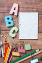 Stationery objects on wooden background Stock Photos