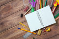 Stationery objects on wooden background Royalty Free Stock Photo