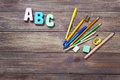 Stationery objects with word abc on wooden background Stock Image