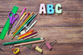 Stationery objects with word abc on wooden background Royalty Free Stock Images