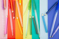 Stationery in a portrait orientation colorful pens placed on colorful notes Royalty Free Stock Photos
