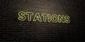 STATIONS -Realistic Neon Sign on Brick Wall background - 3D rendered royalty free stock image