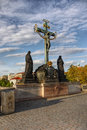 Statuary st cross jesus christ landmark unesco prague of the with calvary on the charles bridge in czech republic the oldest part Stock Image