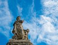 Statue against sky of woman with child blue Royalty Free Stock Photography