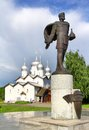 Statue of alexander nevsky in veliky novgorod and church boris and gleb on volhov river s embankment russia Stock Images