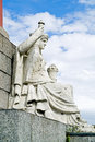 Statue of allegory of the river neva at the rostral column ancient sculpture near base Royalty Free Stock Photos