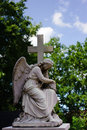Statue of an angel with cross Royalty Free Stock Image
