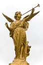 Statue of Angel and trumpet. Royalty Free Stock Photo