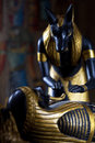 Statue of anubis with the mummy of the deceased on a black background selective focus Royalty Free Stock Images