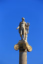 Statue of apollon on the column athens attica greece in fromnt academy building Stock Photos
