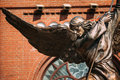 Statue of archangel michael near red catholic with outstretched wings thrusting spear into dragon church st simon and st helena Royalty Free Stock Image