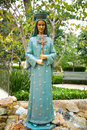 Statue of blessed virgin in san fernando mission stands a garden the Stock Photos