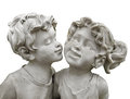 Statue boy kissing girl isolated of a young a young on the cheek on white Stock Photography