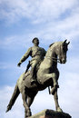 Statue bronze horseback rider against sky Stock Image