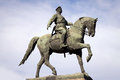 Statue bronze horseback rider against sky Royalty Free Stock Images