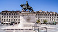 Statue in bronze of king joao i of portugal in figueira square the praca da figueira is a large square in the centre of lisbon in Stock Photo