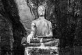 Statue of Buddha in the middle of temple in the mountain. Picture was shot in black and white. Royalty Free Stock Photo