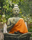 Statue buddhism buddha on a background of green bushes Stock Photography