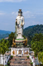 Statue of the buddhist goddess of mercy in the mountains southern thailand Royalty Free Stock Photo