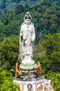 Statue of the buddhist goddess of mercy in the mountains southern thailand Stock Photos