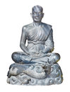 Statue of buddhist monk isolated shot aged stone sitting in lotus pose with dragon below Stock Image