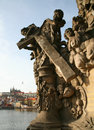 Statue with cherubs from prague baroque style on the charles bridge in castle in the background Stock Images