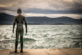 Statue of child by the sea Royalty Free Stock Photo