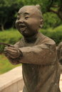 The statue of the child statue:a on his face is plastered a grin purest exhilaration Stock Images