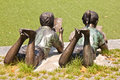 Statue of children reading a book Stock Photography