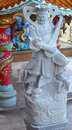Statue of chinese deity in temple Royalty Free Stock Photo