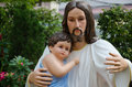 Statue of Christ and Child In Hug. Royalty Free Stock Photo