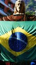 Statue of Christ the Redeemer Brazil Flag Royalty Free Stock Photo